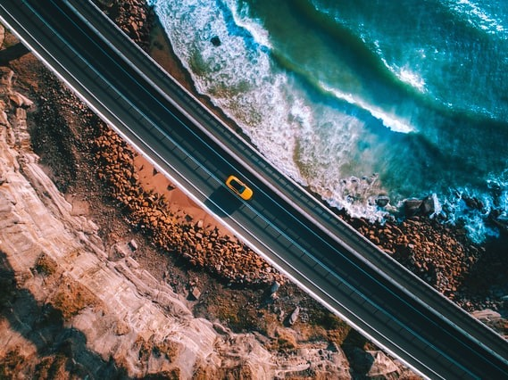 Car from above, cruising over streets
