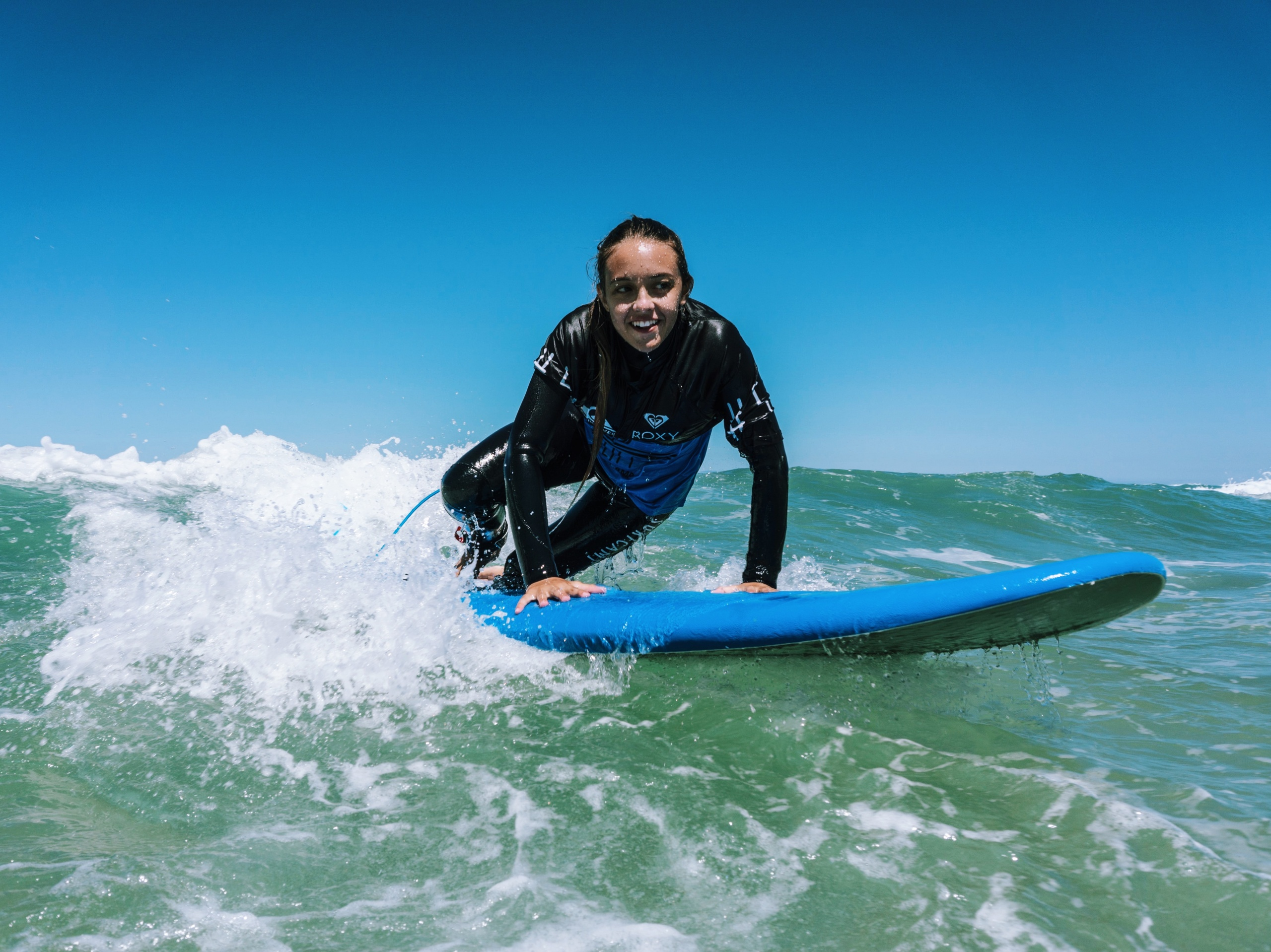 young woman having fun while surfing