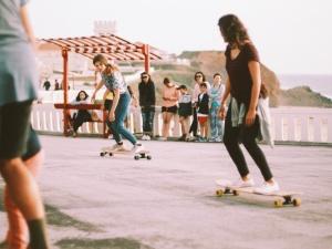 Longboarding girl in Portugal