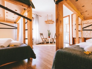 Cozy room with surf style and wooden beds in Portugal Surfcamp