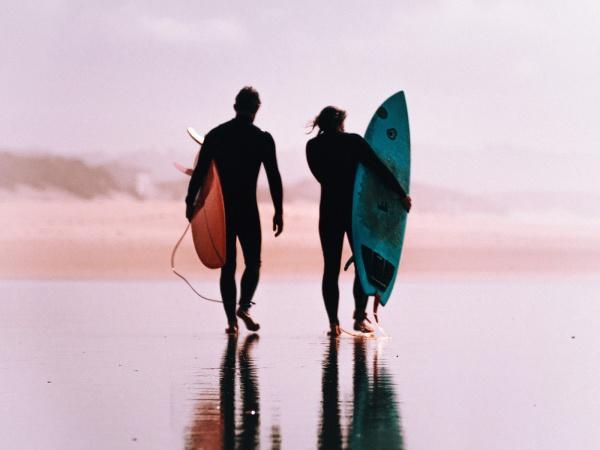 2 men going surfing