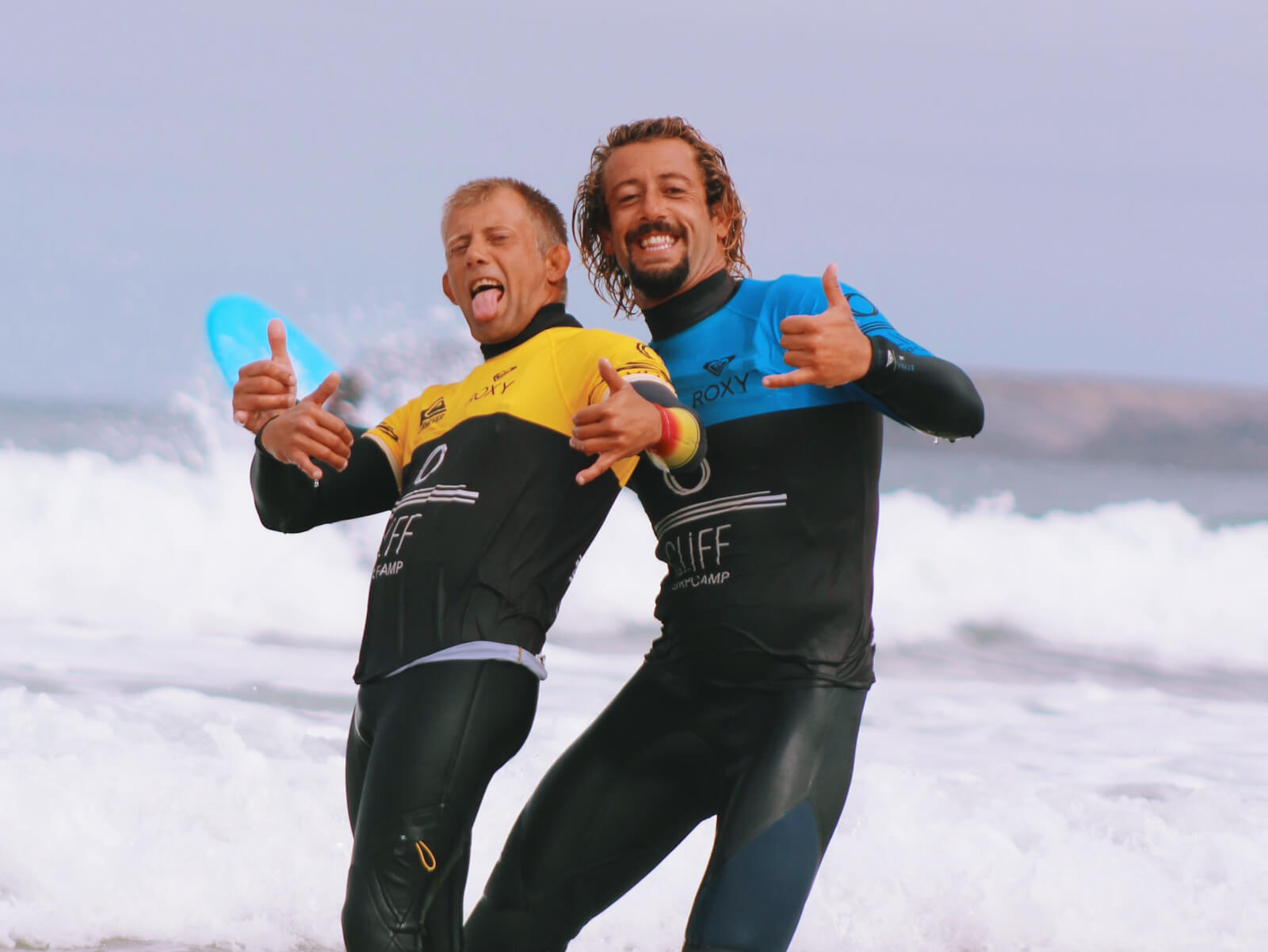 handsome surf coaches having fun in the ocean