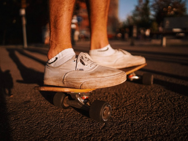 close up image of shoes on a skateboard